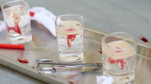 Clear gelatin shots floated with grenadine and Bailey's.