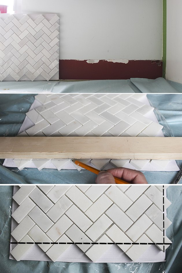 Drawing cut lines on mosaic herringbone tile.