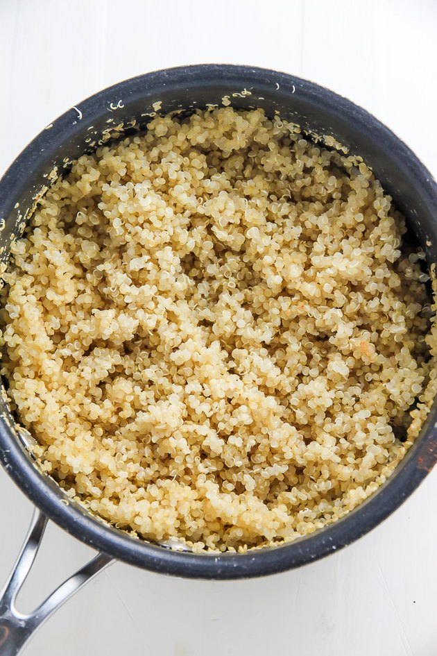 Cook quinoa and transfer it to a large bowl.