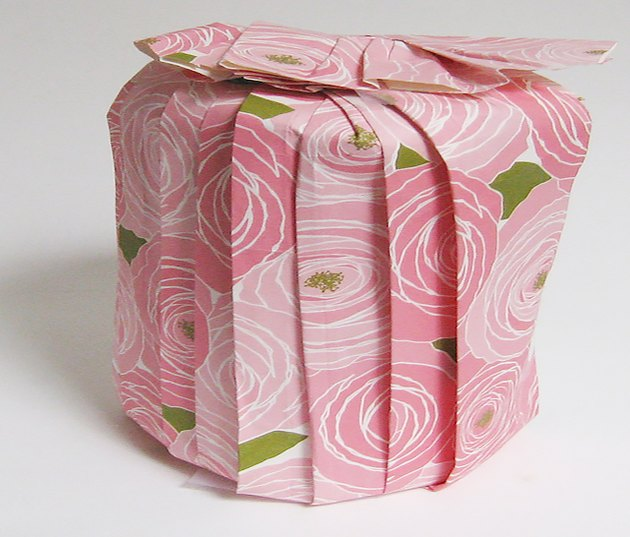 round gift wrapped with pleated paper