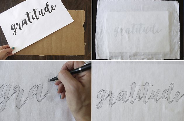 Tracing gratitude text onto fabric with pen.