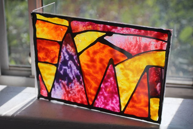 an acrylic picture frame housing a melted crayon design