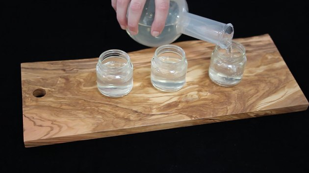 Pouring gelatin mixture into baby food jars