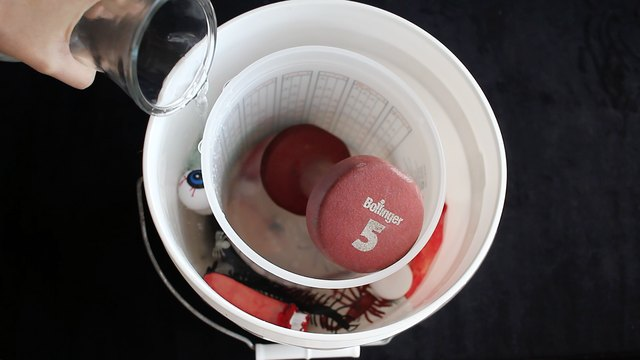 Pouring water into bucket for second layer