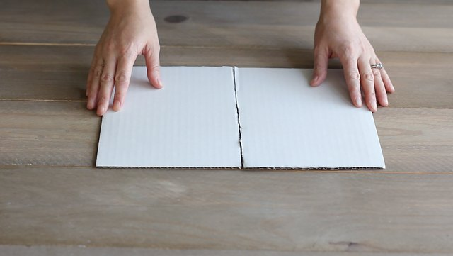 Taping two cake boards together