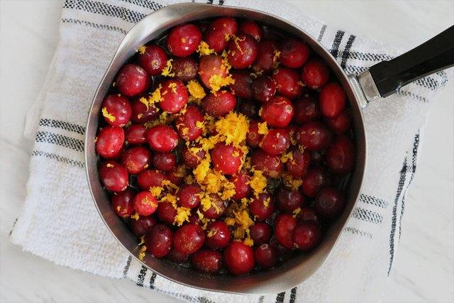 Combine cranberries and orange zest