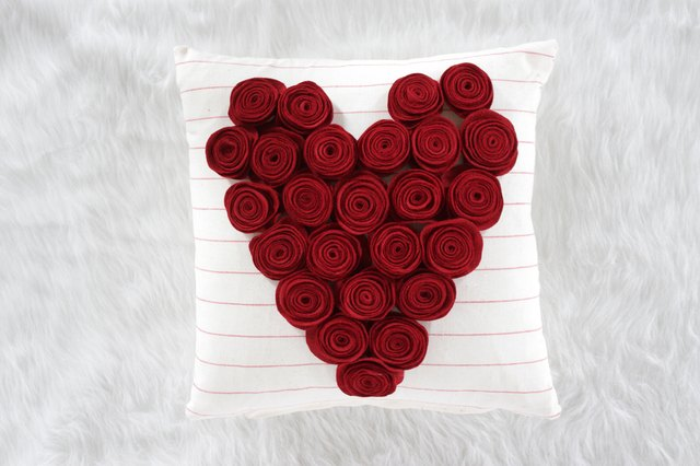 This delightful new rose pillow can be made in an afternoon for your couch, chair or maybe even your love nest.