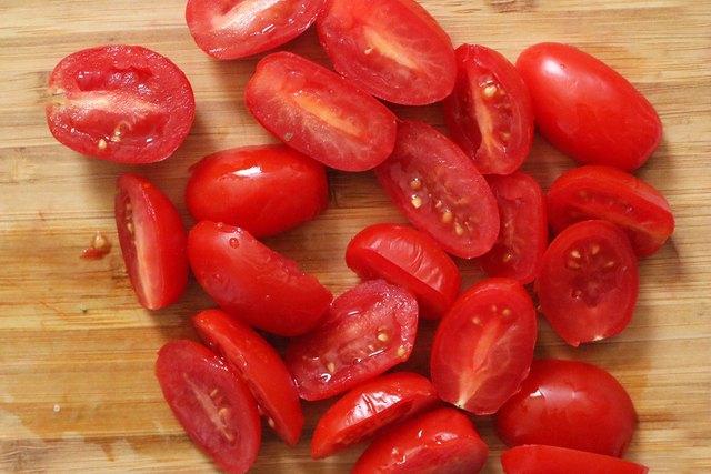 Slice grape tomatoes