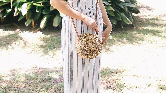 Woman wearing the round basket bag