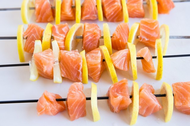 salmon and lemon skewers on a cutting board