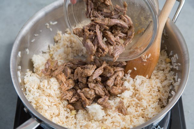 Add pork adobo and two tablespoons adobo sauce