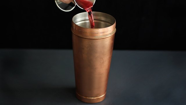 Pouring cranberry juice into cocktail shaker