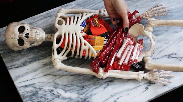 Placing candy inside skeleton