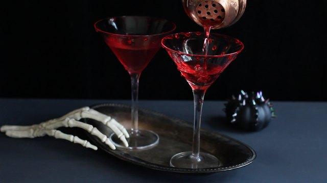 Straining drink into martini glass