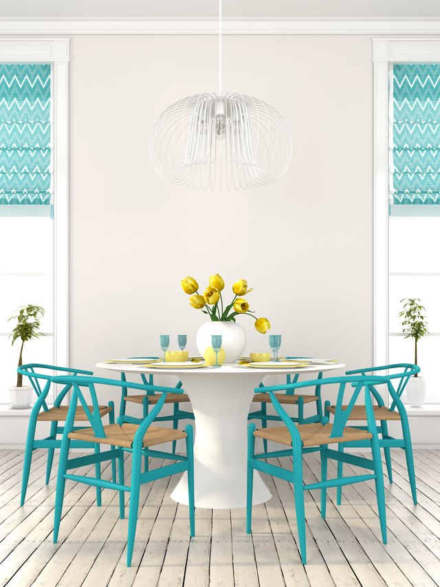 Stylish dining room with blue furniture