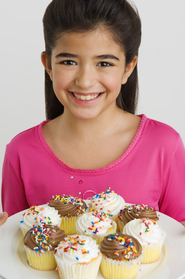 Girl with cupcakes