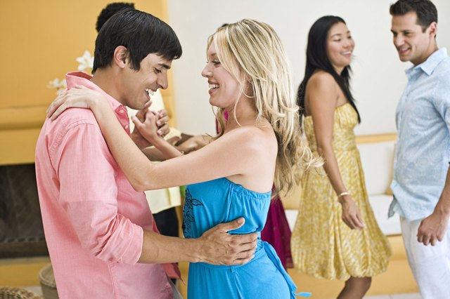 Couple dancing at party