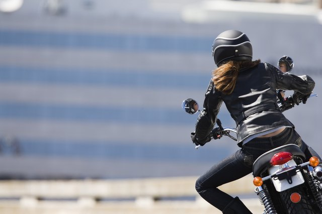 Back view of woman motorcyclist