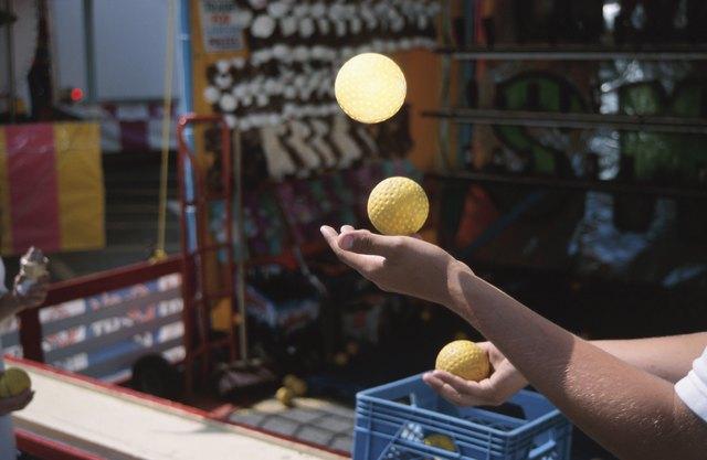 Person juggling balls at carnival