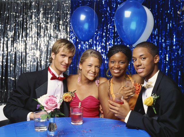 portrait of two teenage couples at a table smiling