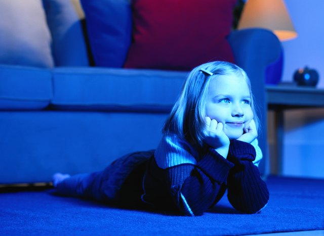 Girl Lying on the Floor Watching Television