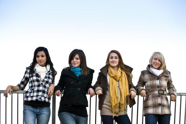 Portrait of stylish teenage girls in jackets
