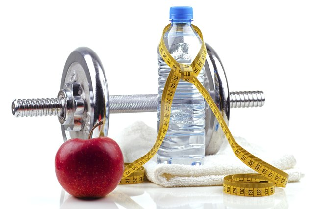 Metal dumbell with red apple and bottle