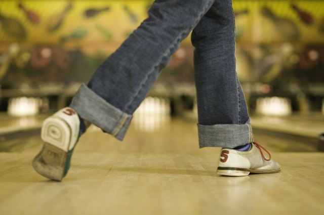 Woman getting ready to bowl ball, low section