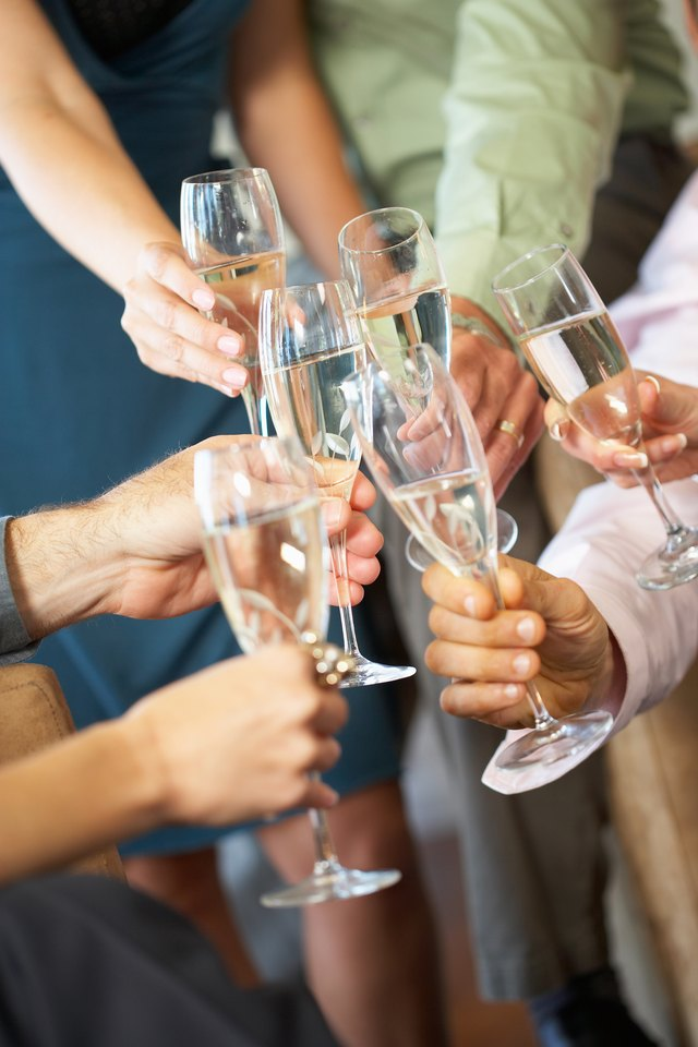 People toasting wineglasses at party
