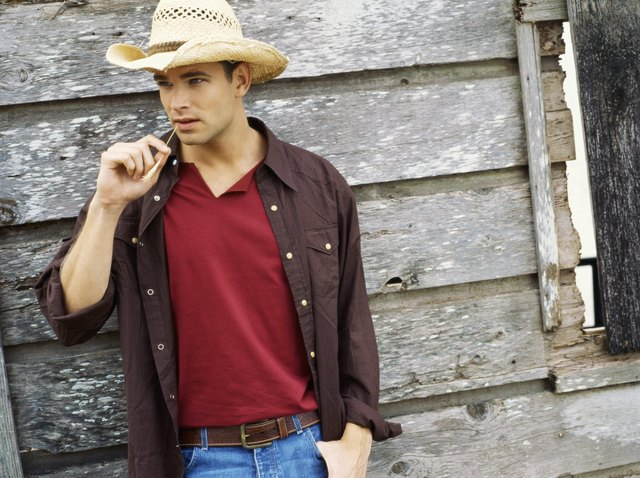 Portrait of a young man wearing a cowboy hat