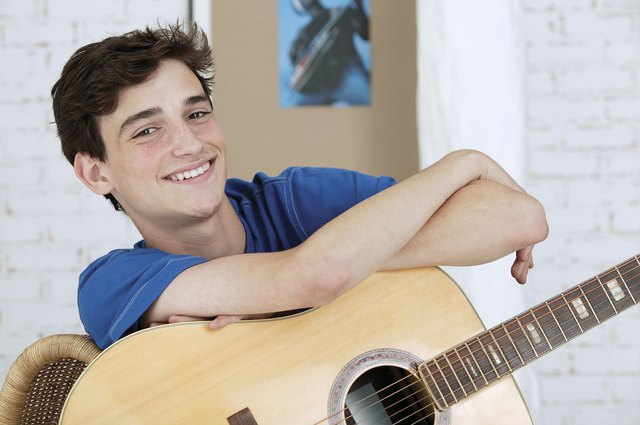 Teenage boy with acoustic guitar