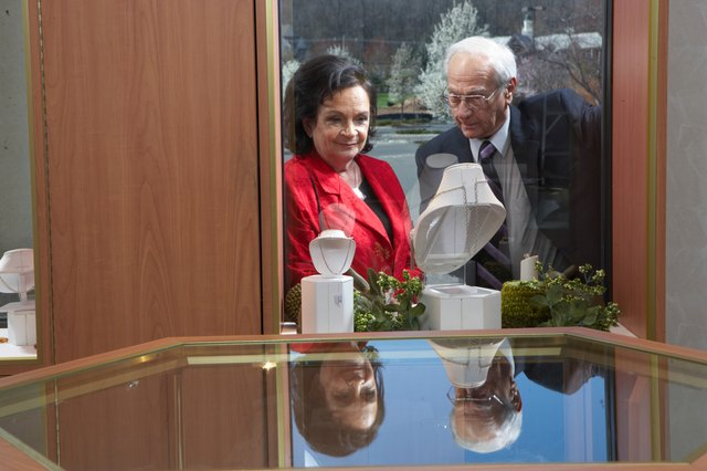 Man and woman looking in window of jewellery store