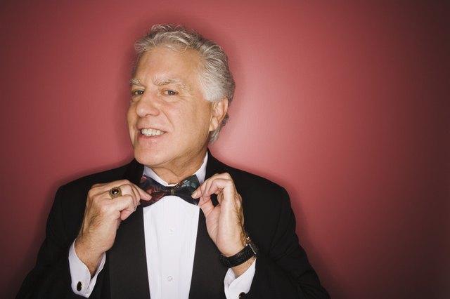 Man adjusting bow tie