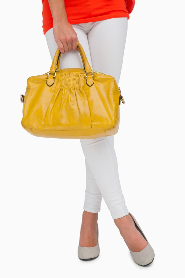 Woman in high heels standing with yellow bag