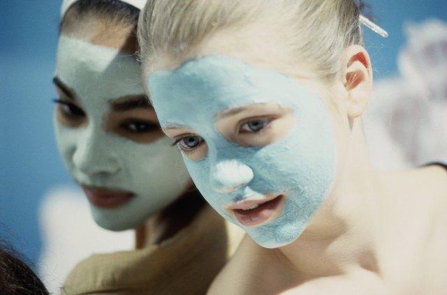 Close-up of two teenage girls wearing facial masks