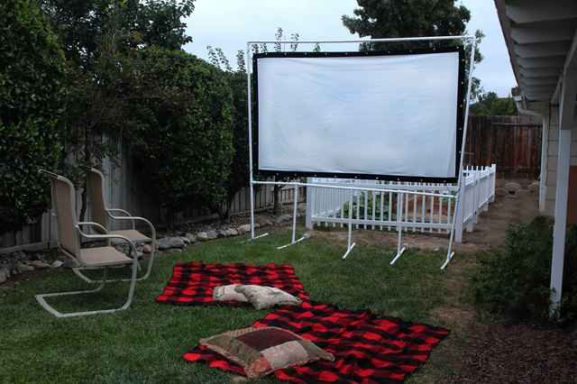 finished movie screen set up outside with chairs and blankets