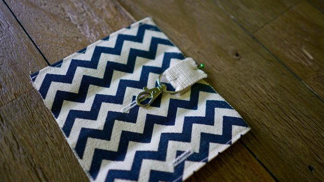Pin clasp onto fabric for DIY dog waste bag dispenser