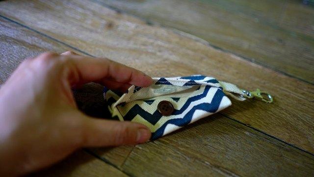 Sewing button onto DIY dog waste bag dispenser