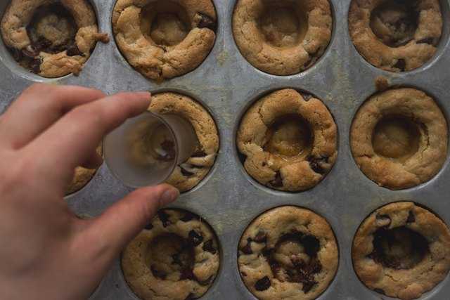 Use the back of a shot glass to form indents in the middle of the cookie cups.