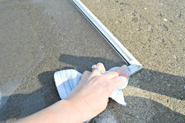 Use a clean cloth to wipe the screen frame
