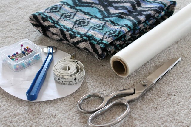 Materials needed to make a fringe cardigan.