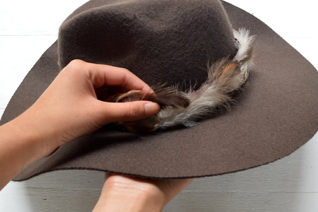 The trim should fit snugly around the top of the hat