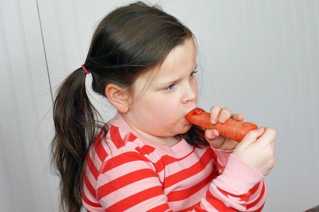 Child playing carrot whistle