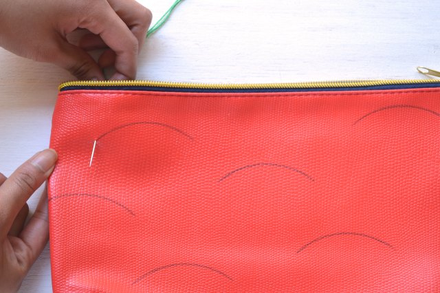 Carefully pierce the fabric with the needle