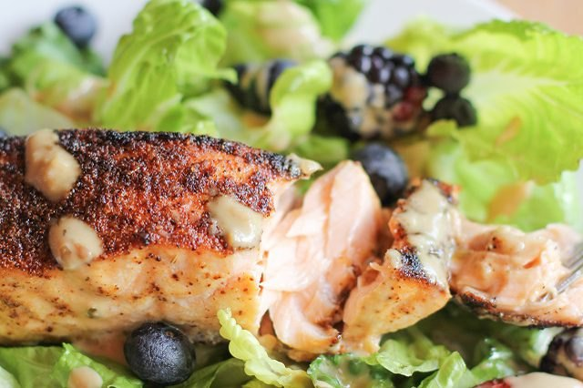 Spiced salmon on a bed of greens.
