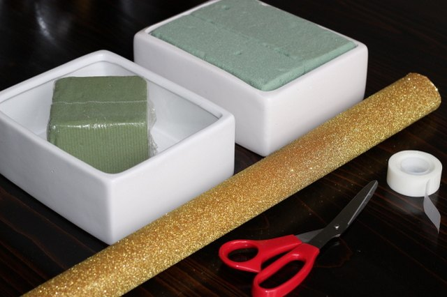 Fill a box with floral foam.