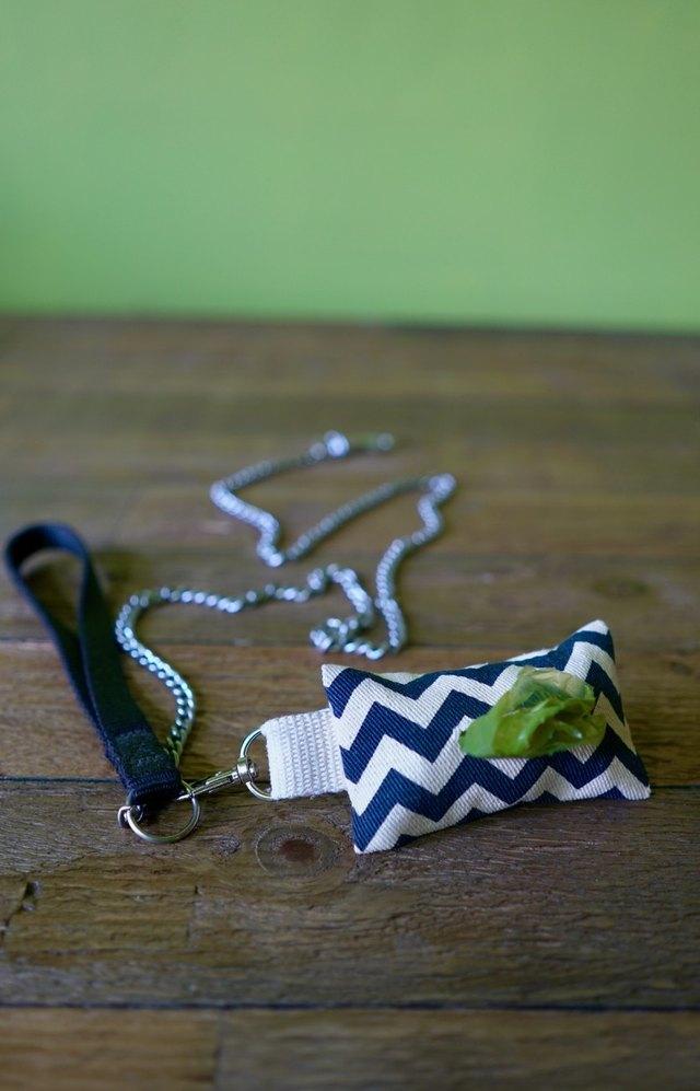 DIY dog waste bag dispenser and dog waste bag roll clipped to leash