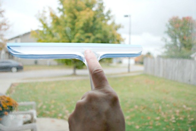 Use a squeegee to wipe away window cleaner.