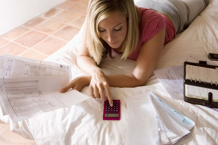 Woman with bills and calculator