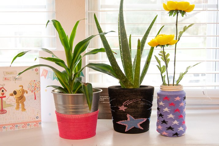 use socks to decorate plant pots